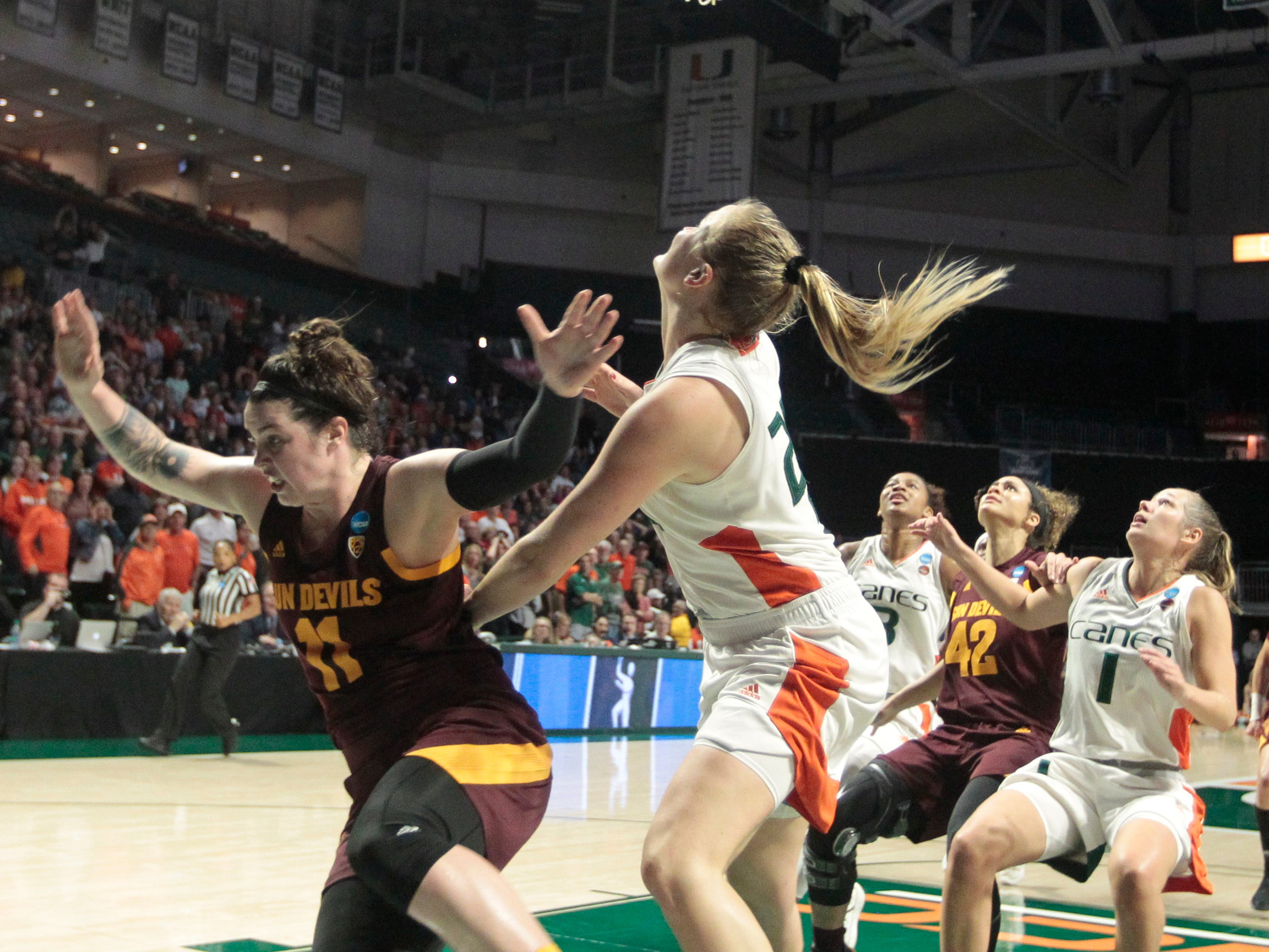 Arizona State's Robbi Ryan (11) is fouled by Miami's Emese Hof, right, as she attempts the go-ahead basket during a second round women's college basketball game in the NCAA Tournament, Sunday, March 24, 2019, in Coral Gables, Fla. Arizona State hit the free throws, and Arizona State won 57-55. (AP Photo/Luis M. Alvarez)