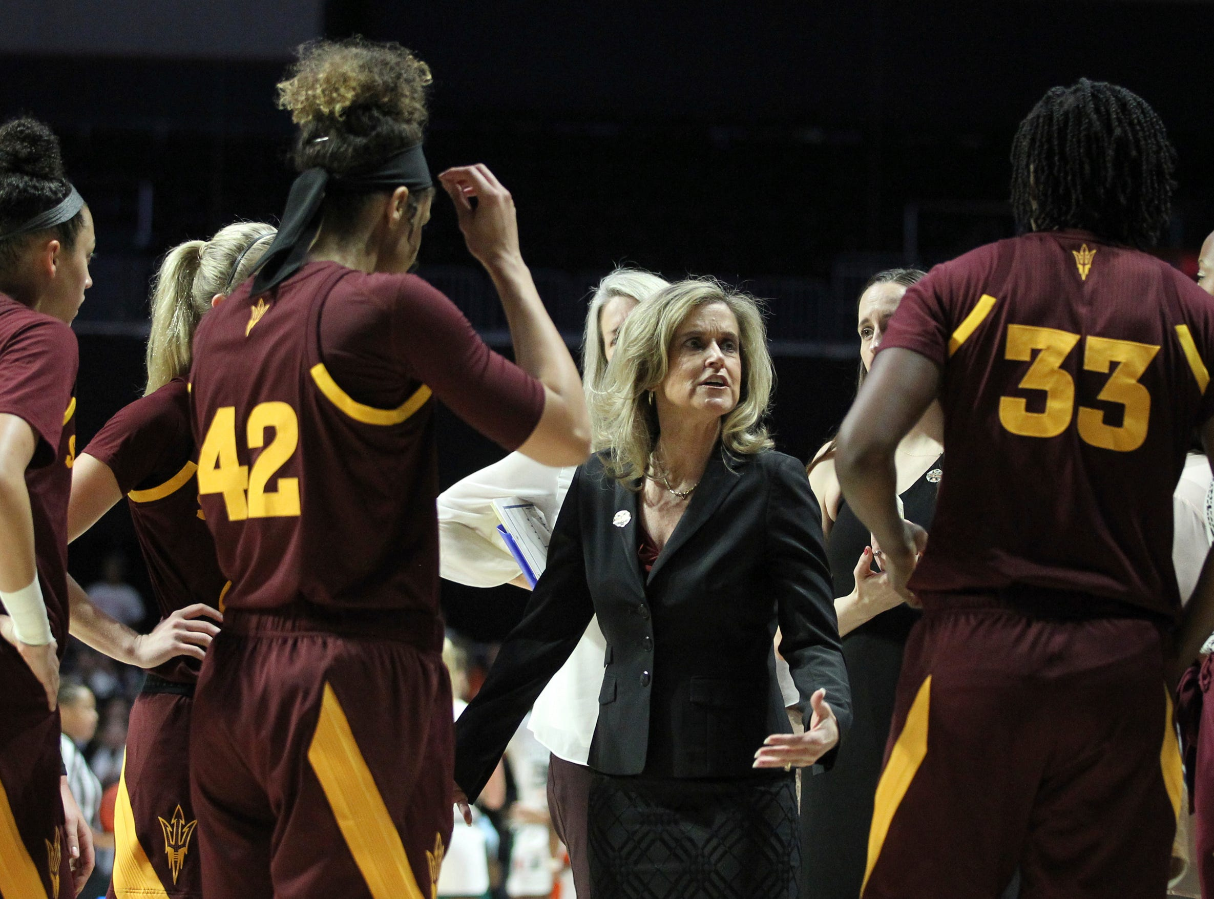 Arizona State coach Charli Turner Thorne, center, talks to her team during a timeout during a second-round women's college basketball game against Miami in the NCAA Tournament, Sunday, March 24, 2019, in Coral Gables, Fla. (AP Photo/Luis M. Alvarez)