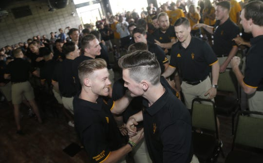 ASU's Joshua Maniscalco (R) hugs teammate Connor Stuart (2) during a NCAA Selection Show watch party at Papago Golf Course in Phoenix, Ariz. on March 24, 2019.