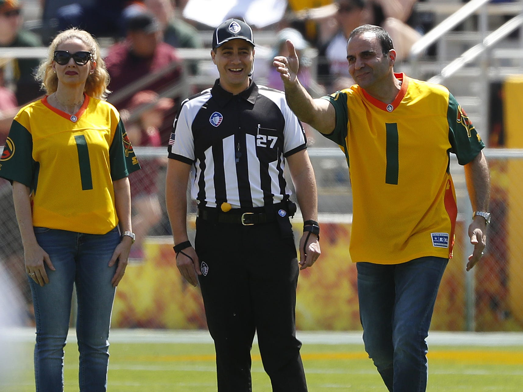 Sheriff Paul Penzone signals a first down before the first half at Sun Devil Stadium in Tempe, Ariz. on March 24, 2019.