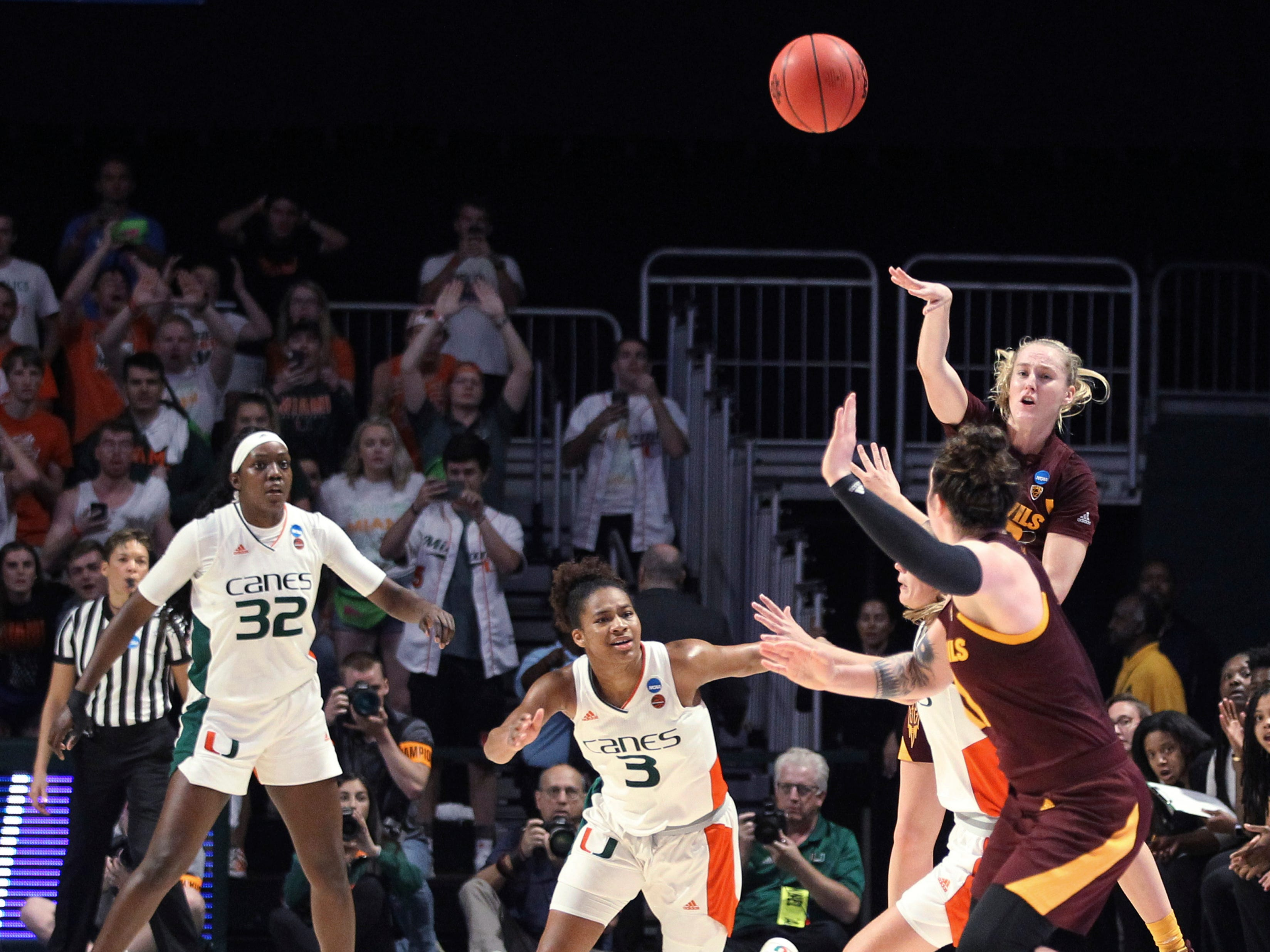 Arizona State's Courtney Ekmark, top right, throws the ball to reammate Robbi Ryan, front right, as Miami's Beatrice Mompremier (32) and Endia Banks (3) defend during a second-round women's college basketball game in the NCAA Tournament, Sunday, March 24, 2019, in Coral Gables, Fla. Arizona State won 57-55. (AP Photo/Luis M. Alvarez)