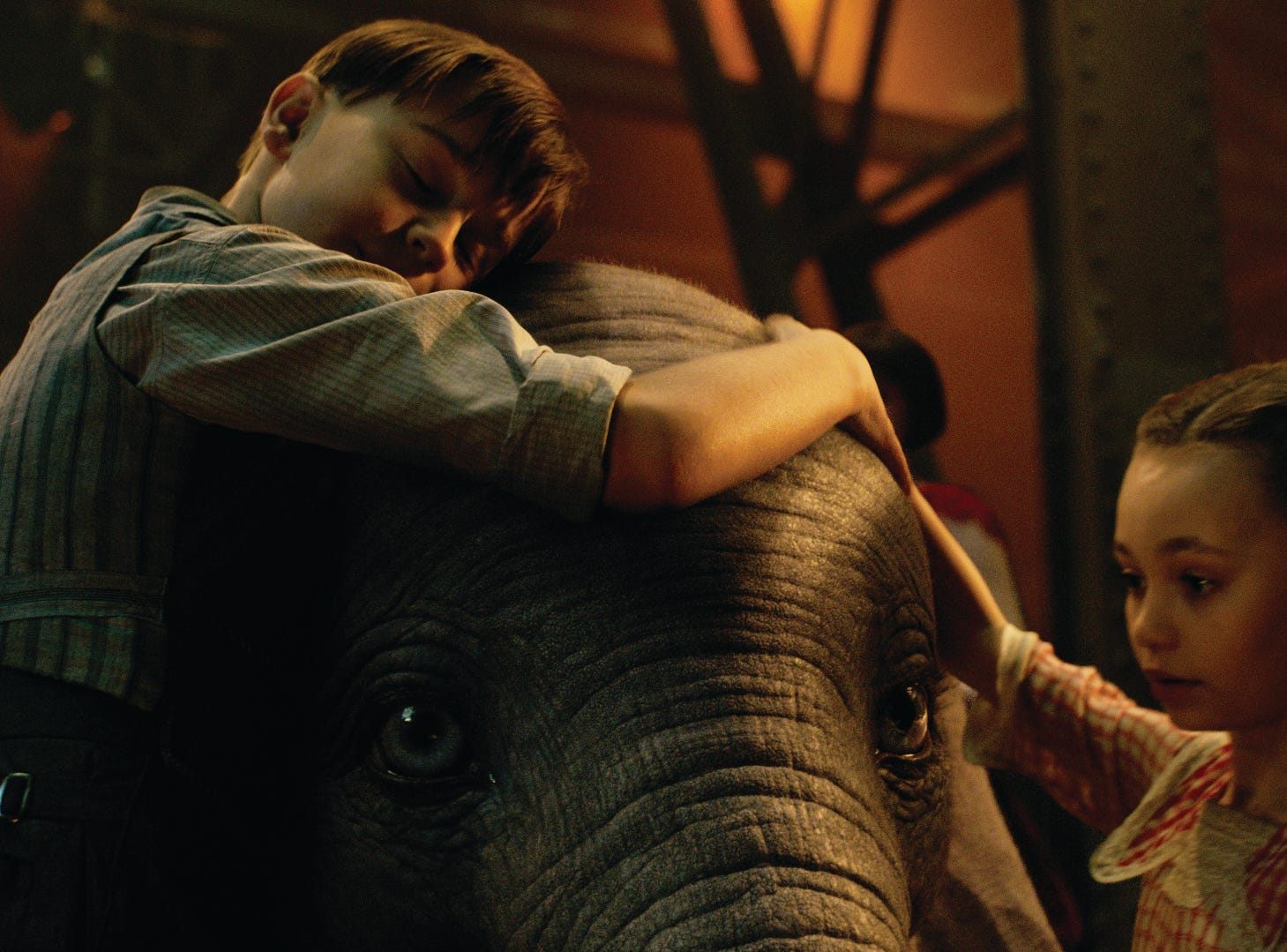 "Joe (Finley Hobbins) and Milly (Nico Parker) fall hard for the title character in ""Dumbo."""