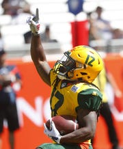 The Arizona Hotshots' Deion Holliman celebrates a touchdown at Sun Devil Stadium in Tempe, Arizona, on March 24, 2019. Holliman was sidelined when the Alliance of American Football league ceased operations and filed for bankruptcy in April 2019.