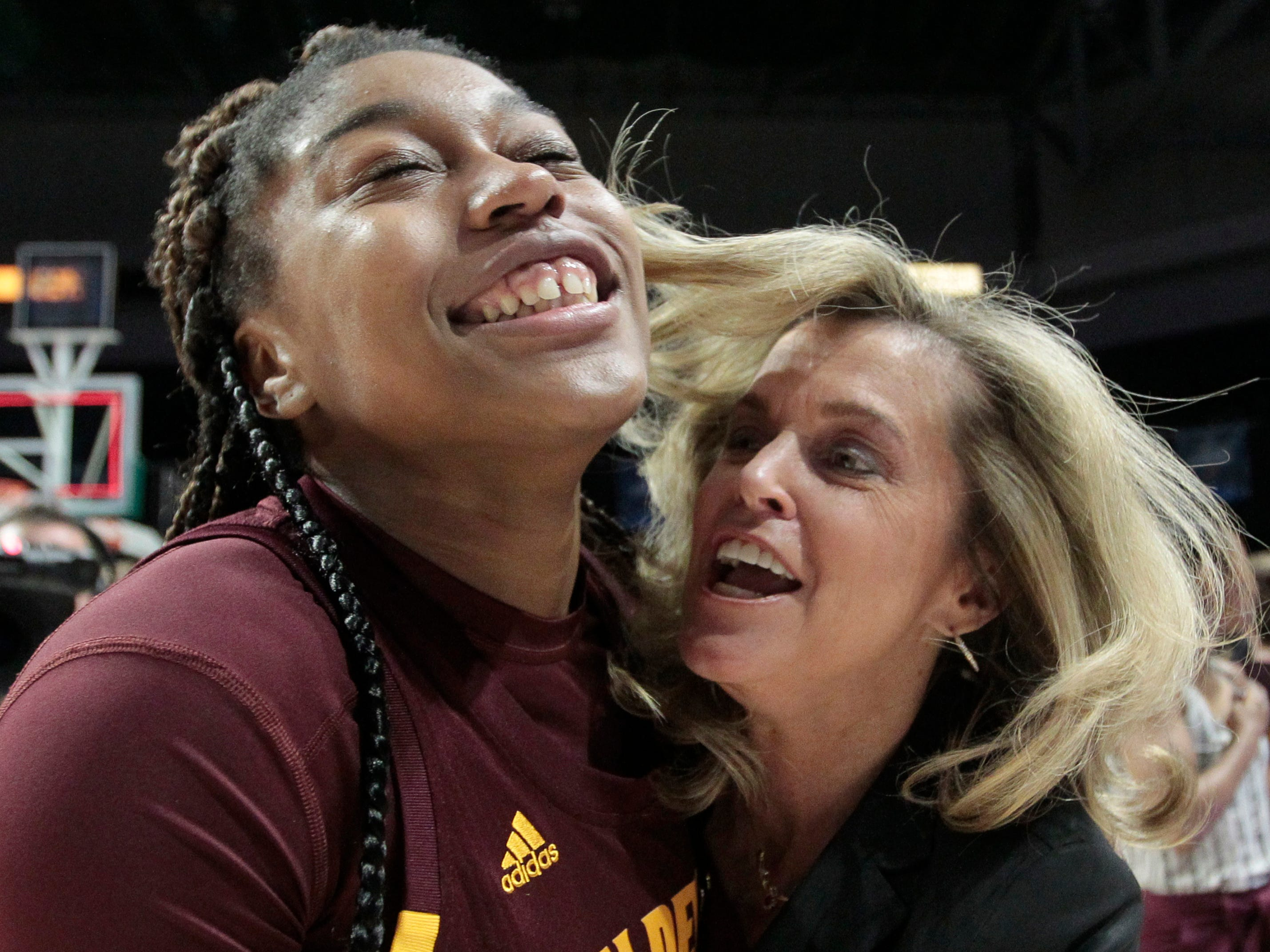 Arizona State's Bre'yanna Sanders, left, hugs coach Charli Turner Thorne after the team's 57-55 win over Miami during a second-round women's college basketball game in the NCAA Tournament, Sunday, March 24, 2019, in Coral Gables, Fla. (AP Photo/Luis M. Alvarez)