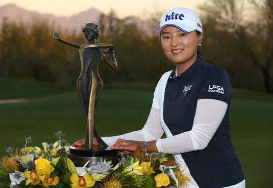 Jin Young Ko of South Korea poses with the trophy after winning the Bank of Hope Founders Cup on Mar. 24, 2019 at Wildfire Golf Club at JW Marriott in Phoenix, Ariz.