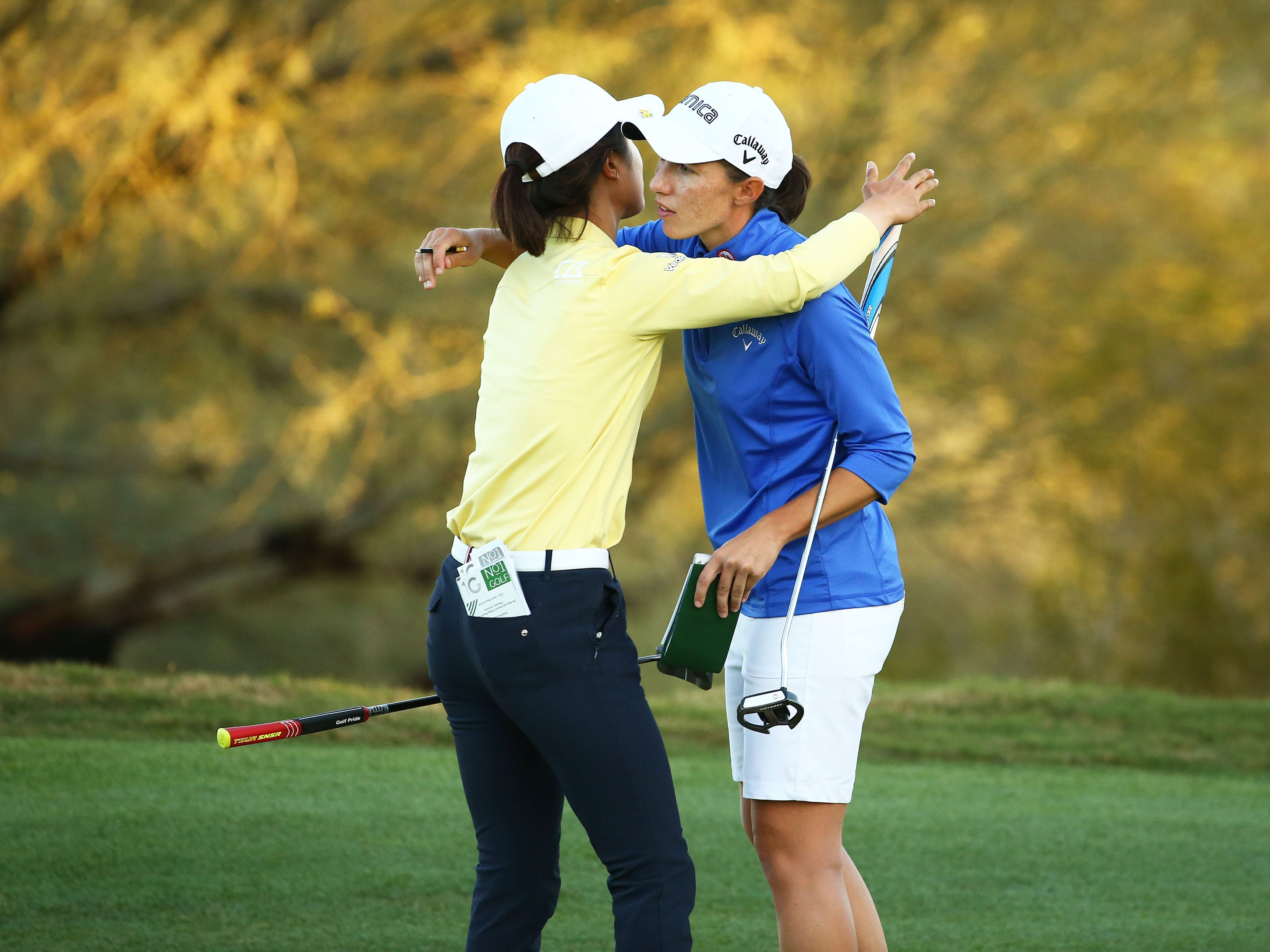 Yu Lia of China and Carlota Ciganda of Spain hug after finishing their final round at the Bank of Hope Founders Cup on Mar. 24, 2019 at Wildfire Golf Club at JW Marriott in Phoenix, Ariz.
