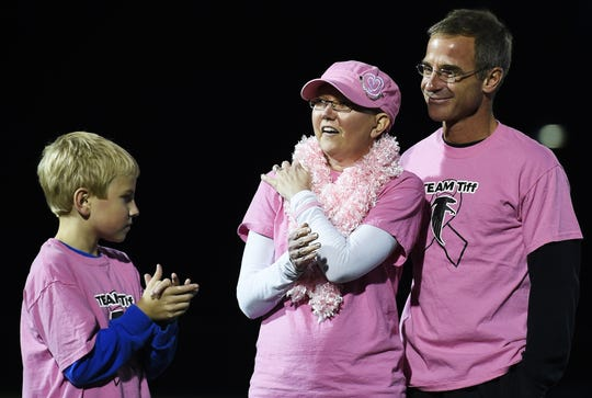 Tiff and Rob Bare along with their son Zach, cheer on the Cedar Crest Field Hockey team Monday night October 6, 2014 against McCaskey High School as the team held a cancer benefit for the Bare family.