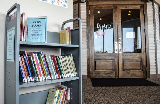 Bistro 163 was an ideal place for a free book cart because so many local residents, as well as the soon-to-arrive tourists,  frequent the restaurant. Plus, its pay-it-forward concept pairs perfectly with the idea of free books.