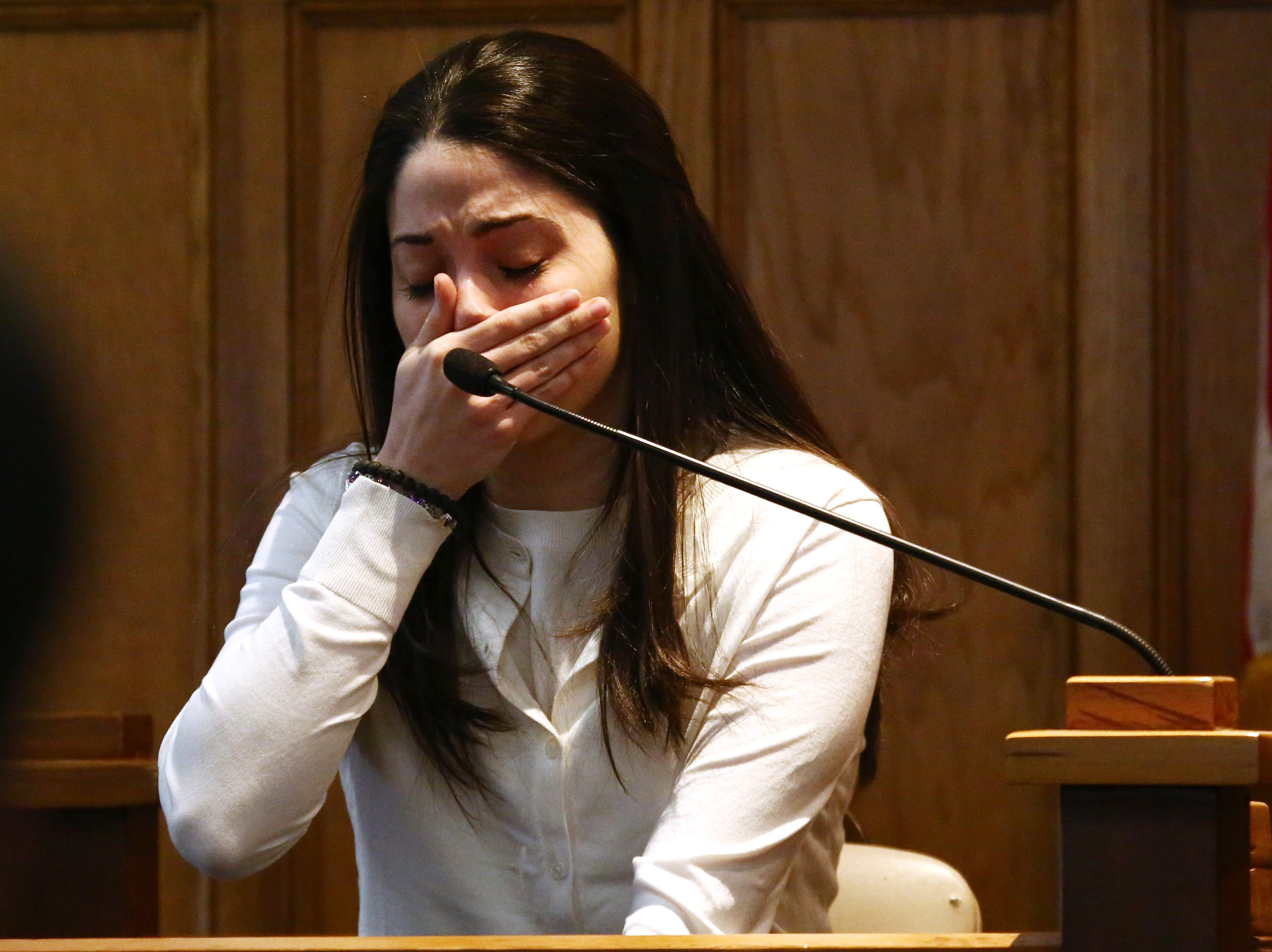 Nicole Addimando shows emotions while talking about her children while on the witness stand during her murder trial in the courtroom of Hon. Edward McLoughlin on March 25, 2019.