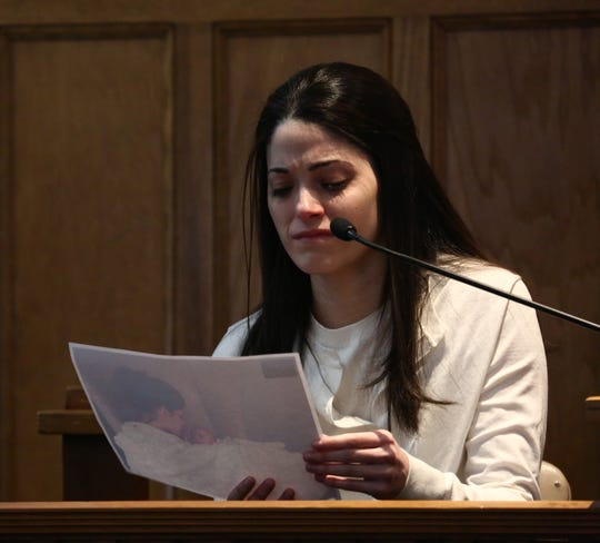 Nicole Addimando reviews a photo of her and her son while testifying in Dutchess County Court Monday.The photo shows a bruise on her temple, which she stated was given to her by her partner Christopher Grover.