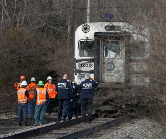 Crews inspect the damage to the Metro North train that collided with a dump trailer crossing the tracks at Corbin Road in Pawling on March 25, 2019.