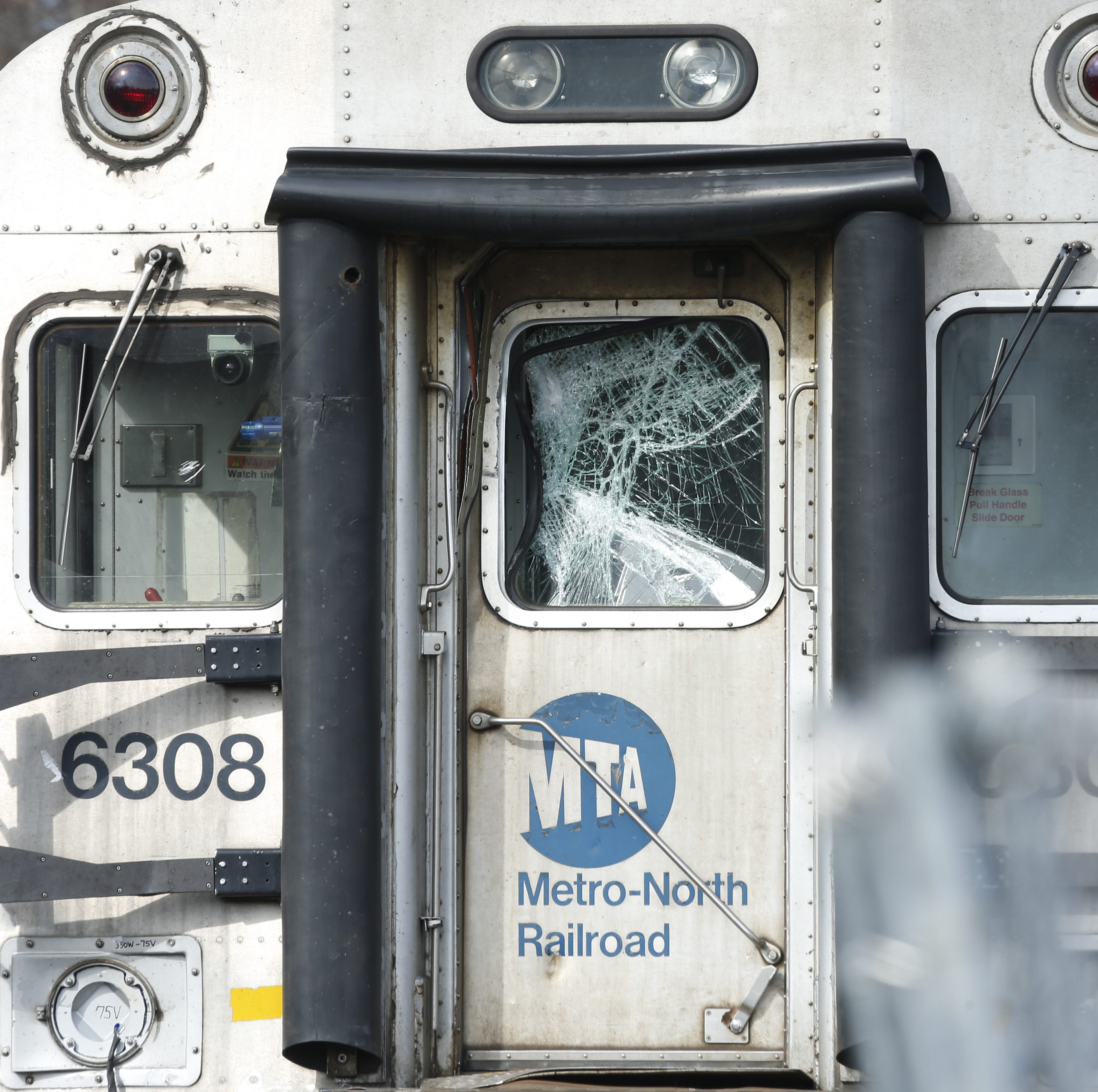 A Metro-North train has visible damage after striking a tractor-trailer on the Harlem Line Monday.