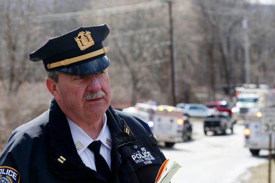 MTA police captain John Kerwick speaks near the  scene where a Metro North train traveling south from Wassaic collided with a dump trailer crossing the tracks at Corbin Road in Pawling on March 25, 2019.