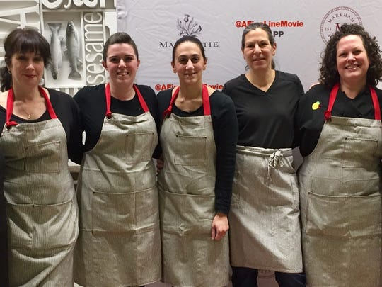 """Babette's Kitchen all-woman staff, left to right, Victoria Pozza, Jessica Quick, Carolyn Morabito, Beth Daidone and Buffy Arbogast, are shown during the March 1 premiere of the documentary """"A Fine Line"""" at the Culinary Institute of America in Hyde Park."""
