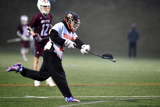 York Suburban's Dominic Corto shoots and scores against New Oxford in the first period on Monday night, becoming the all-time leading scorer in Trojans boys' lacrosse history. He broke Colin Mailman's record.