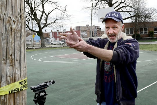 Cottage Hill Road resident Jerry Mellen describes, Monday, March 25, 2019, the position of the person who shot into a crowded Williams Park in York City Sunday. York City Police reported that two minors were shot Sunday afternoon at the park near the intersection of Smith Street and Cottage Hill Road. Bill Kalina photo