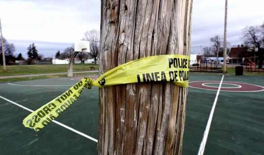 Remnants of a police line remain on a pole at Williams Park Monday, March 25, 2019, after a person shot from that location, according to witnesses, at people in the park. Police reported that two minors were shot Sunday afternoon at the park near the intersection of Smith Street and Cottage Hill Road. Bill Kalina photo