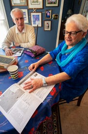 Rich Santel, left, and Pat McGrath, instructors and participants in OLLI, show course materials. OLLI (Osher Lifelong Learning Institutes) is an education program for older adults. The OLLI program is one of the nonprofits that benefits from Give Local York.