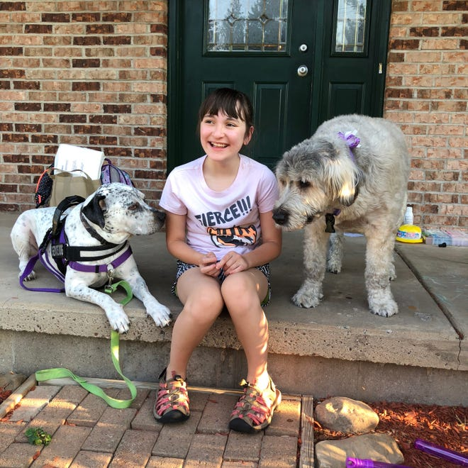 Devyn Pereira with her service dogs Rubin and Hannah. Hannah has since died.