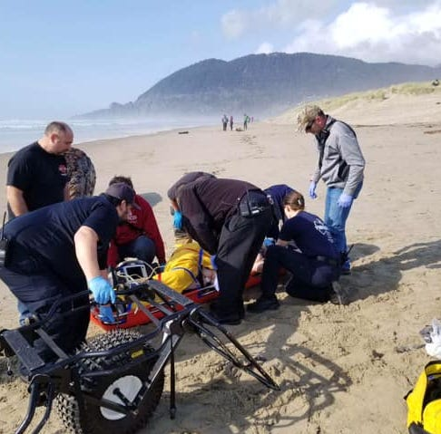 Woman crushed by log after large wave hits Nehalem Bay beach