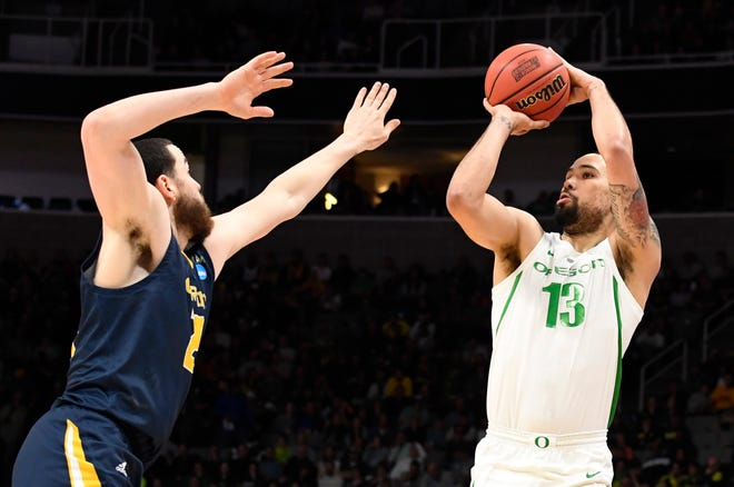 Mar 24, 2019; San Jose, CA, USA; Oregon Ducks forward Paul White (13) shoots against the UC Irvine Anteaters during the first half in the second round of the 2019 NCAA Tournament at SAP Center. Mandatory Credit: Kelley L Cox-USA TODAY Sports