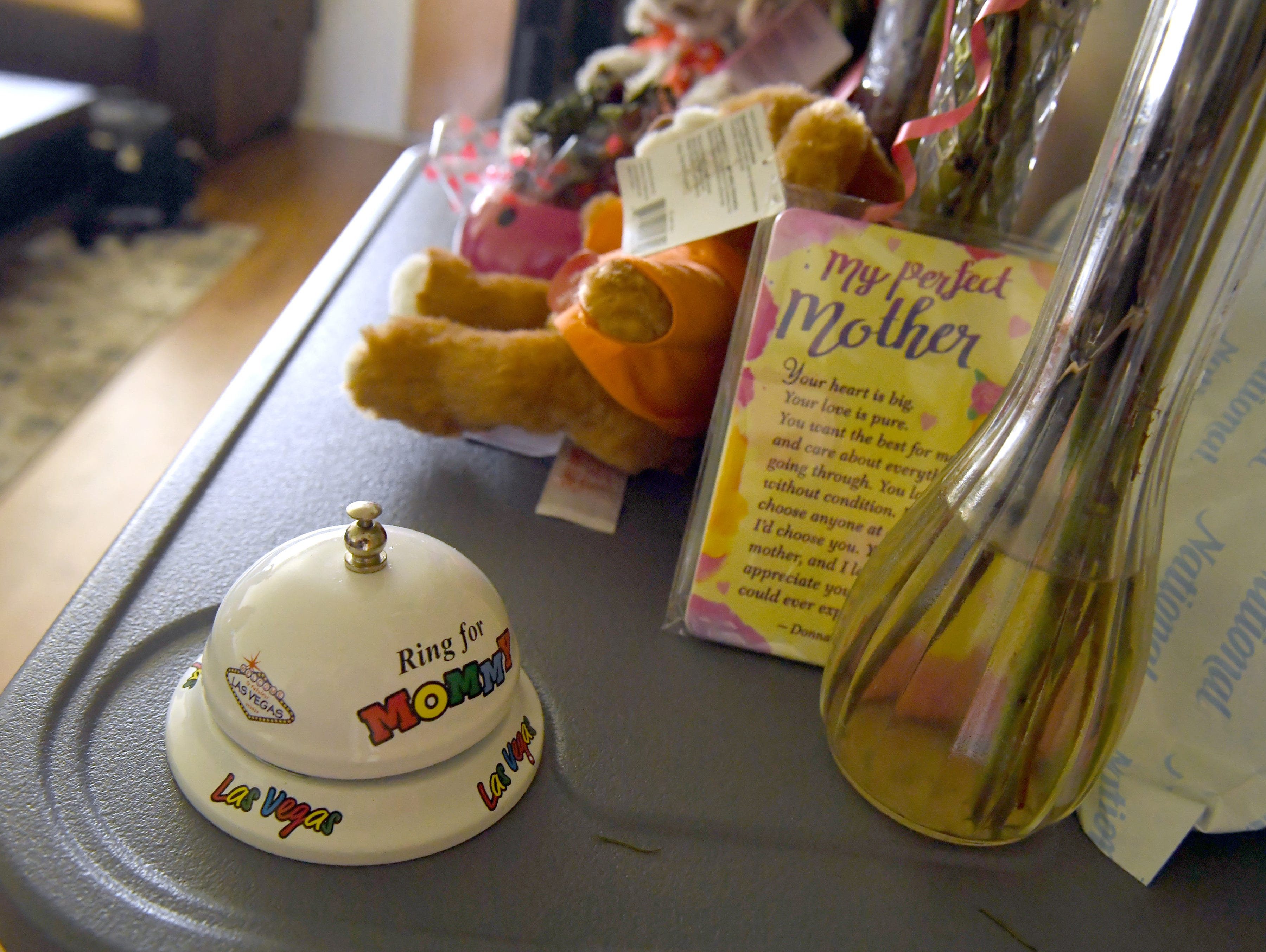 """A bell to """"Ring for Mommy"""" sits along other gifts for Gloria Torrez at her Salinas home."""