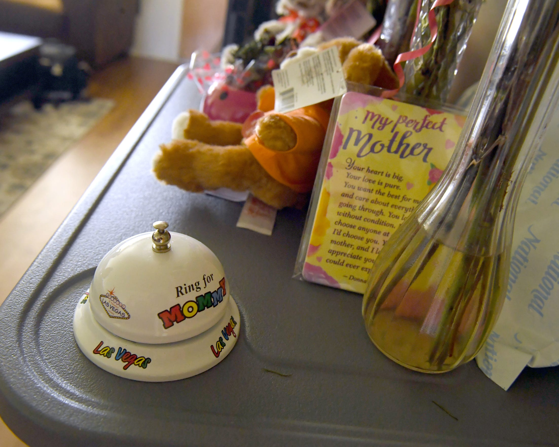 "A bell to ""Ring for Mommy"" sits along other gifts for Gloria Torrez at her Salinas home."