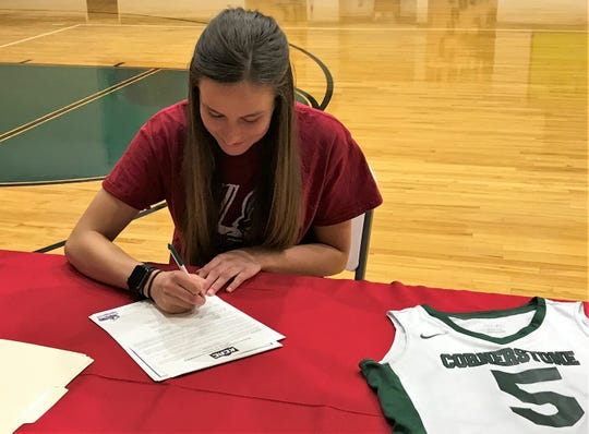 Cornerstone Christian's Hannah Slate signed a basketball scholarship with Sterling College in Kansas on Monday, March 25, 2019.