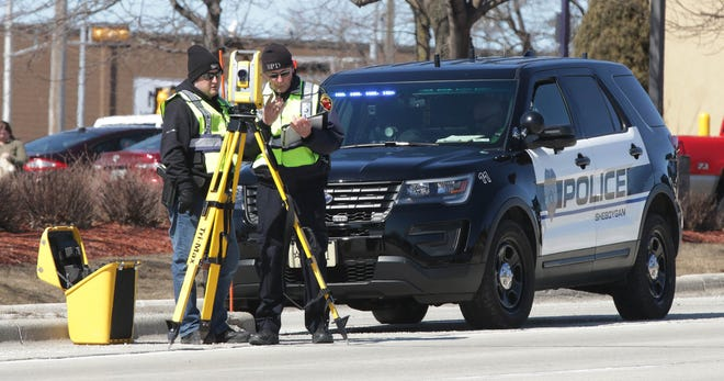 Sheboygan Police investigate an accident in which a vehicle struck a pedestrian on Monday, March 25, 2019, in Sheboygan, Wis.