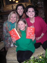 Author Mary Adkins, of New York, (clockwise, from seated) and party hostesses Ellen Brown, Paula Hickman and Patti Harper  take time for a photo op during a book signing party at Harper's Ellerbe Road area home.