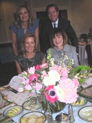 The 2019 VIP players for the Demoiselle Club's debutante doings at the Notebook Luncheon at Shreveport Club: Demoiselle Club Executive Director Lori Allen (clockwise, from seated right), 2020 Demoiselle Club Ball Chairwoman Michele Hardtner, and the luncheon hosts, 2019 Ball Chairwoman Mary Tipton, Demoiselle Club Prez Patrick Lukacs.