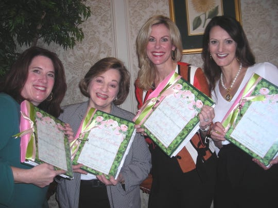 Tracy  Prestwood, Earleen Bergeron, Ginger Lukacs, Dodie Brown   represented Demoiselle Debs at the Demoiselle Notebook Luncheon. They hold out notebooks for the year passed out by Ball Chairwoman Mary Tipton.