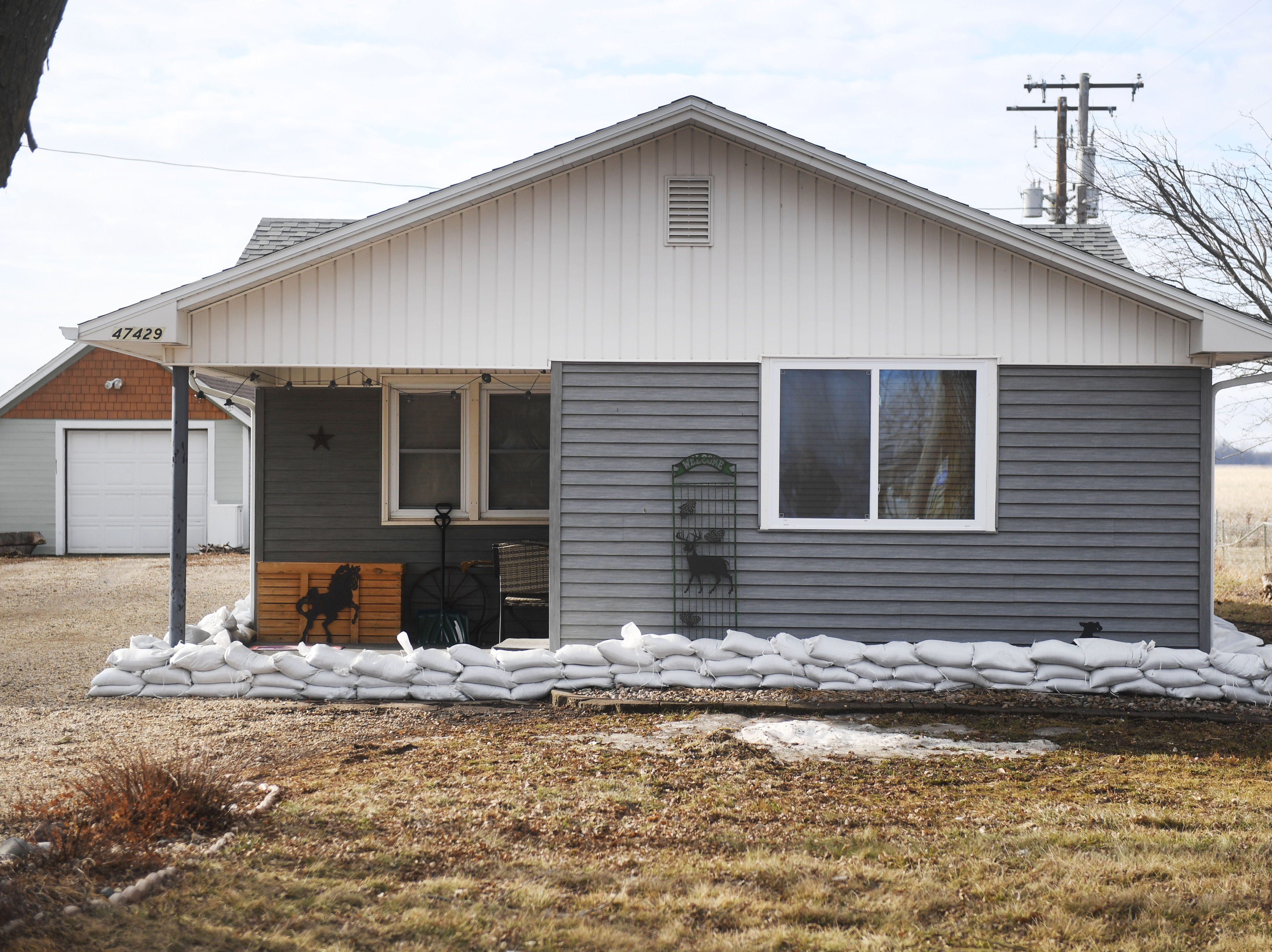 Homeowners placed sandbags, tarp and tape up around their home to keep from flooding in Renner Monday, March 25, in Renner, S.D.