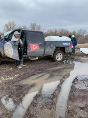 Oglala Sioux Tribe Department of Corrections delivers water to people last weekend.