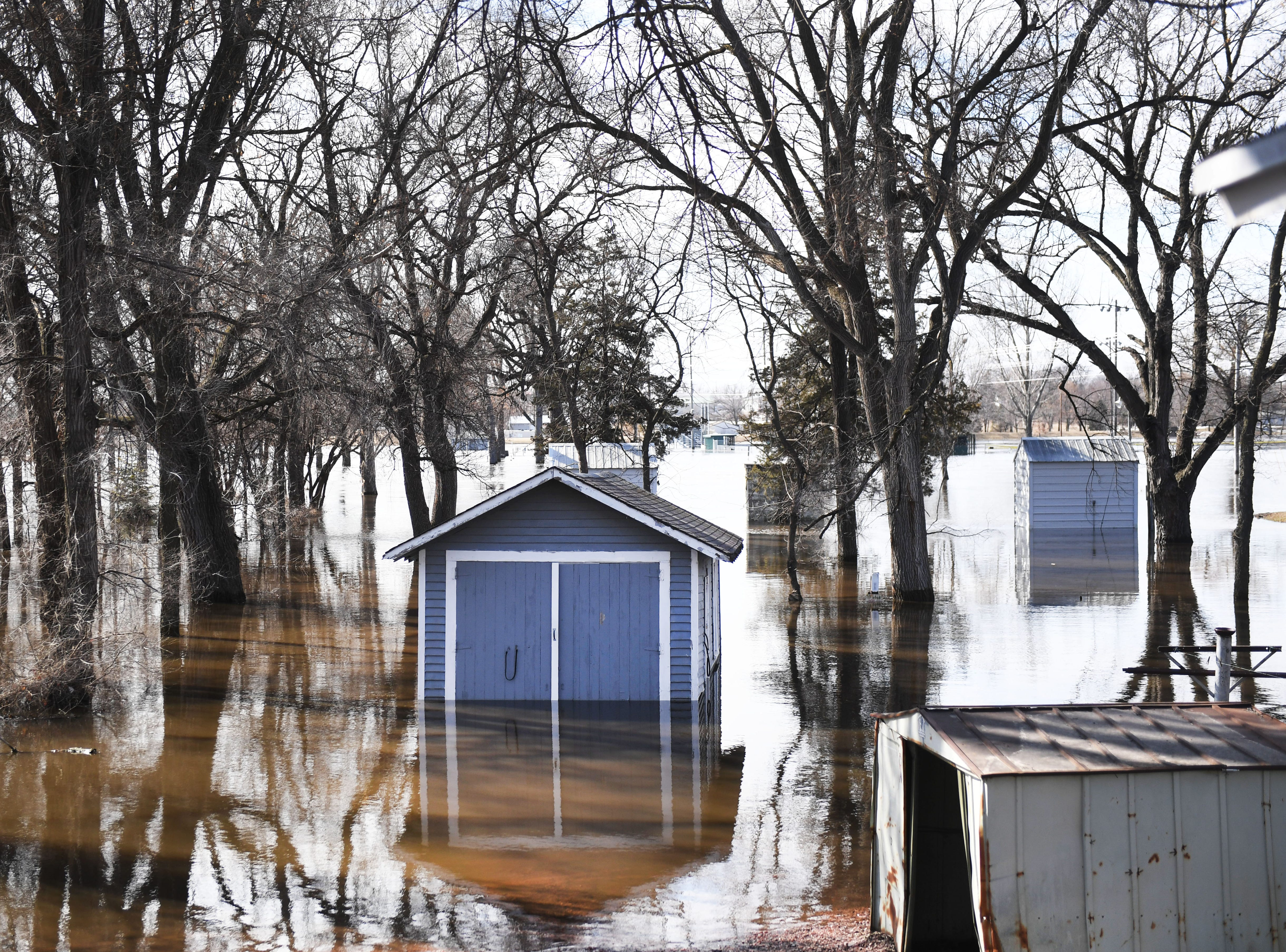 Sheds are flooded in Dell Rapids Monday, March 25, in Dell Rapids, S.D.