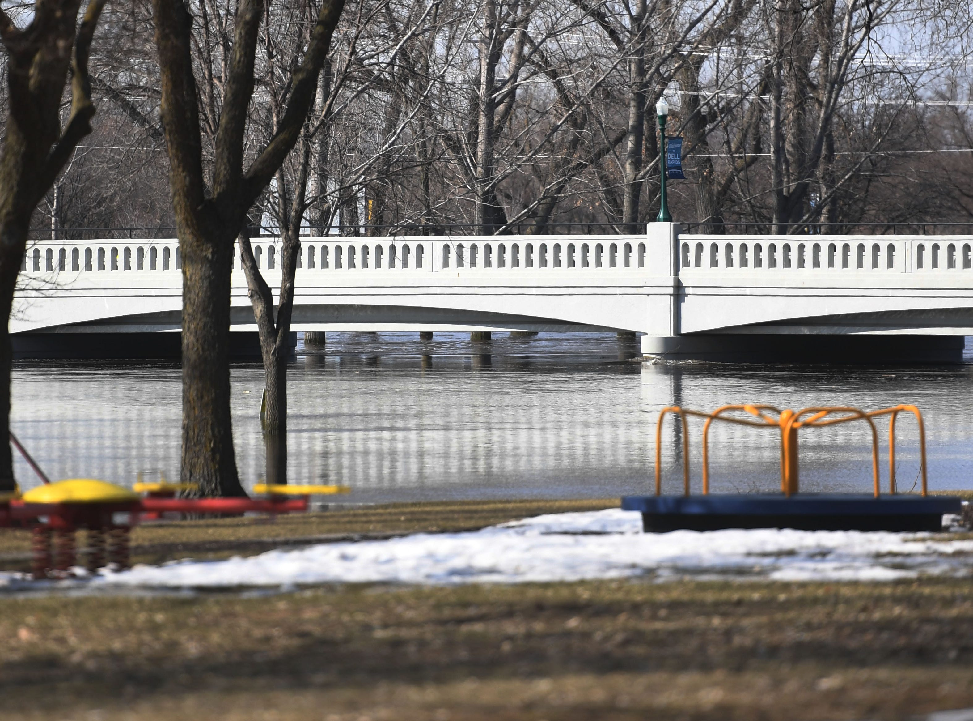 Water nearly reaches underneath a bridge in Dell Rapids Monday, March 25, in Dell Rapids, S.D.