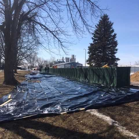 Watertown constructs military barrier wall ahead of flooding