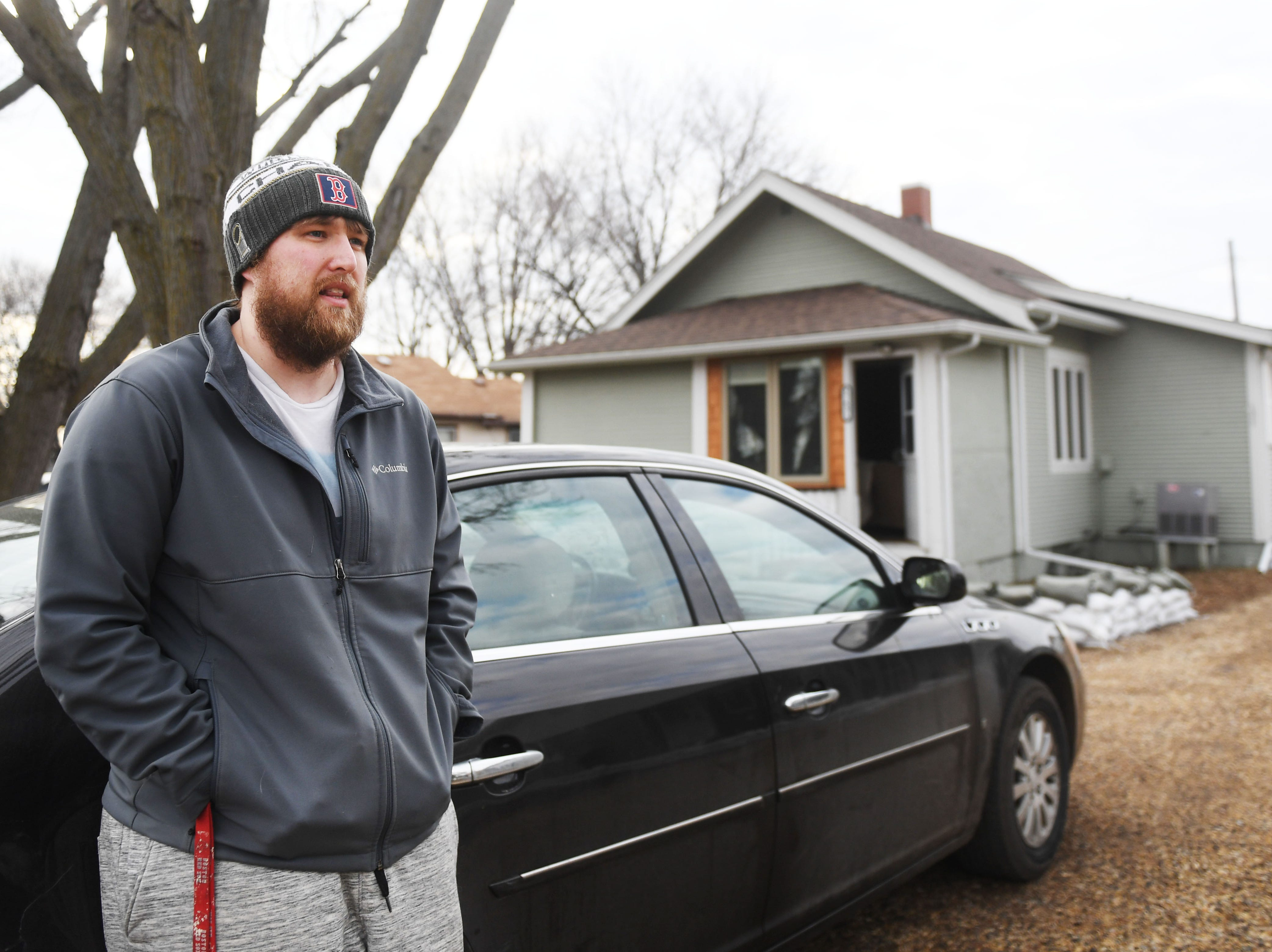 Ben Glanzer talks about evacuating his home in Renner because of flooding Monday, March 25, in Renner, S.D.  Glanzer said just the structure is insured. He grabbed everything of importance just in case.