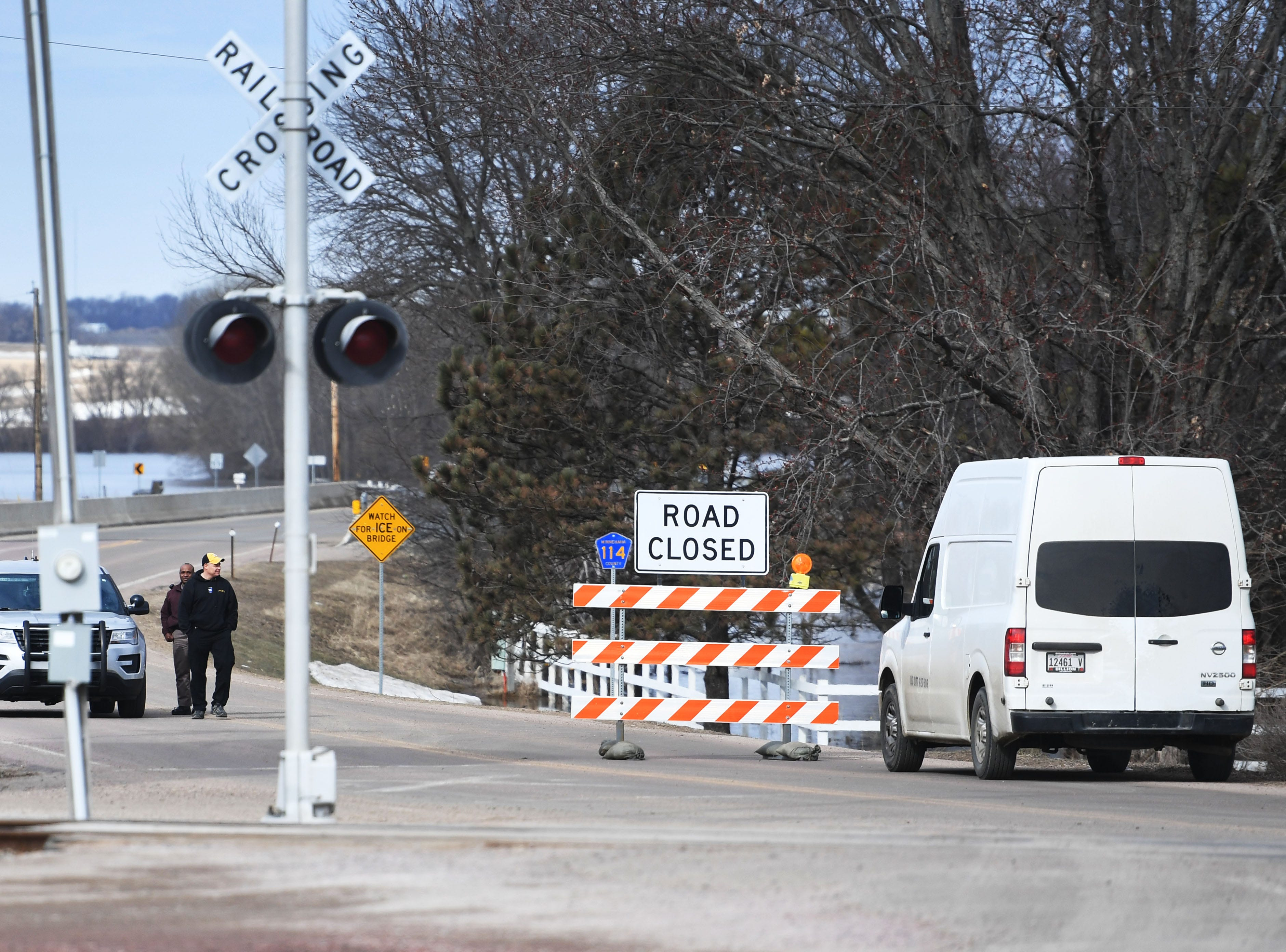 "Officials turn motorist away from passing the ""road closed"" signs because of flooding in Baltic Monday, March 25, in Baltic, S.D."
