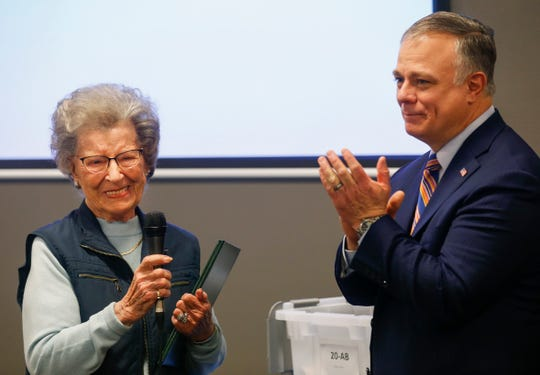 Greene County Clerk Shane Schoeller, right, applauds Marjorie Shelton after she delivered a speech after she was recognized for her 65 years as a Greene County election judge on Monday, March 25, 2109.