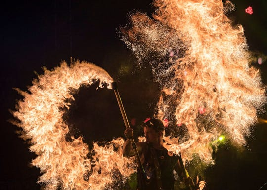 A fire spinner from Phoenix Fire, Phoenix Fire, a world leader in pyrotechnic and special effects theatrics, joining Silver Dollar City's Festival of Wonder in 2019. The festival runs Wednesdays-Sundays, April 10-28 (closed Easter).