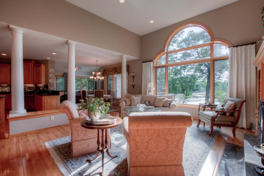 The entry to the home offers clear views of the back yard and the landscape via a large picture window in the living room.