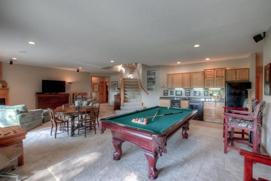 The lower level is large enough to accommodate a seating area with gas fireplace and additional space for a billiards table or recreation area.