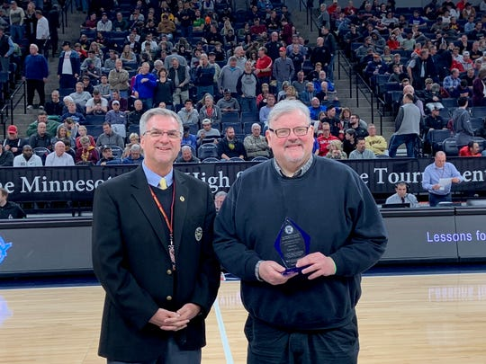Tim Leighton of the Minnesota State High School League presents St. Cloud Times prep sports coordinator Tom Elliott with the league's 2019 Outstanding Media Service award Saturday, March 23, in St. Paul.