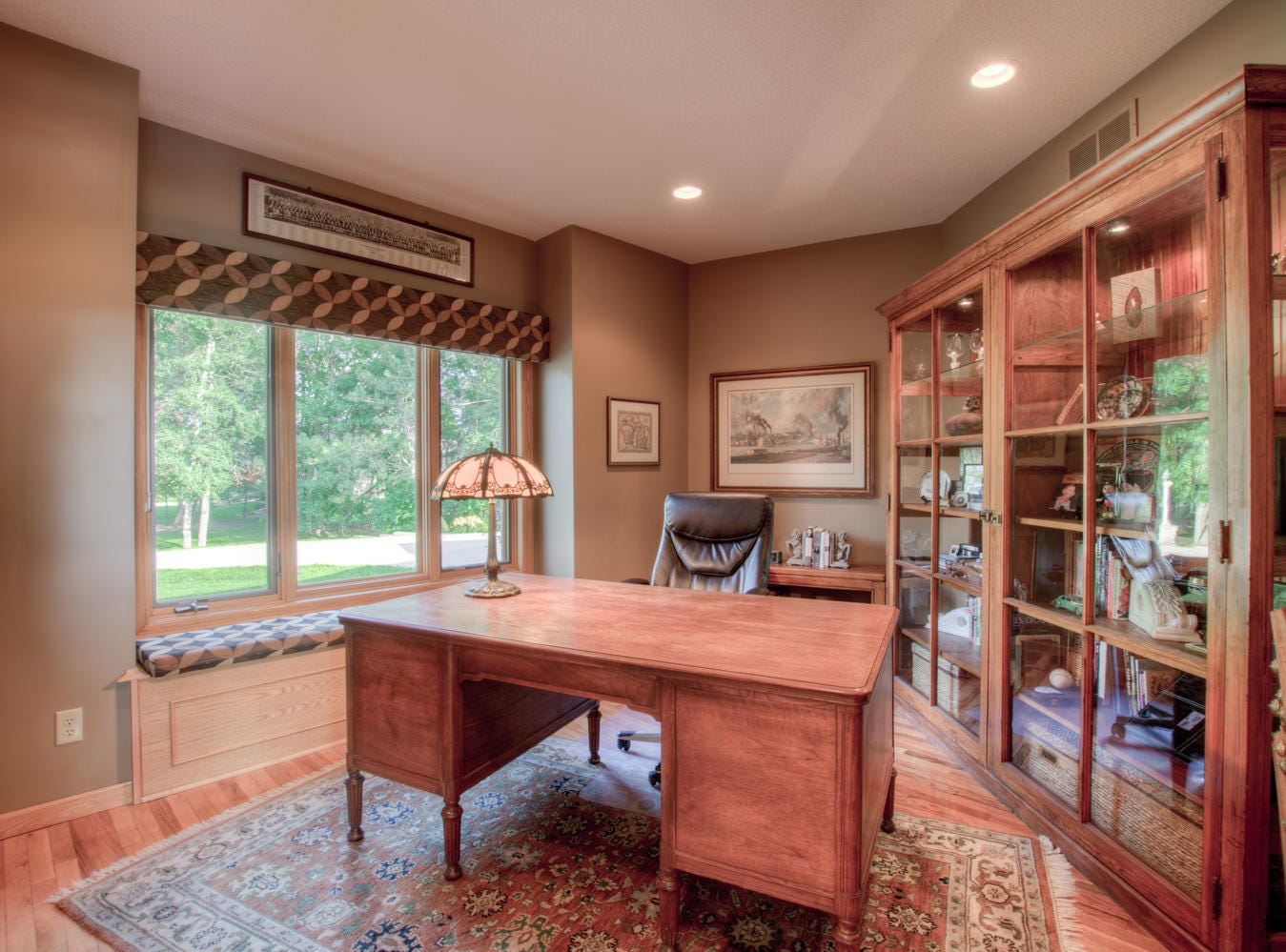 The main floor offers a private home office, finished with a built-in window seat.