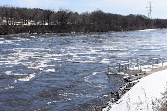 A fishing pier just below the St. Cloud Dam was nearly underwater Monday. The National Weather Service has issued a flood warning for the Mississippi River at St. Cloud starting Wednesday morning. Monday morning the river was at 8.6 feet. Flood stage is 9 feet.