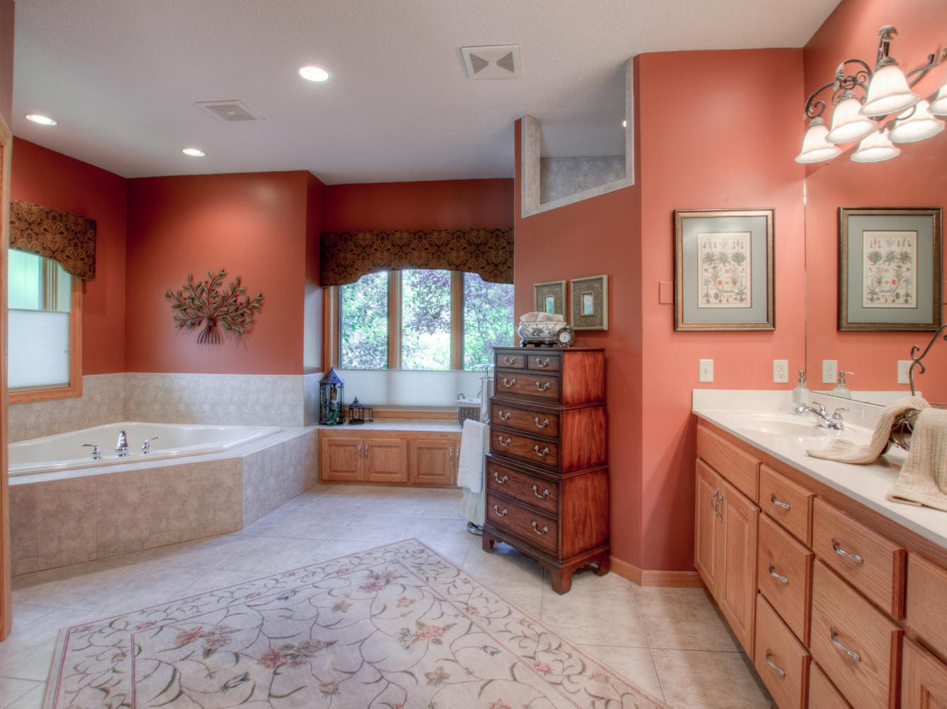 The en suite is large, complete with a soaking tub, double vanity and a water closet.