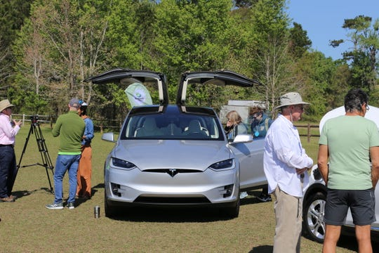 Teslas and other electric vehicles were on display at the Sustainability Summit on March 23.