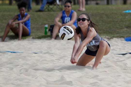 Maclay junior Abby Watson digs a ball during the preseason beach volleyball classic at Tom Brown Park Monday, March 25, 2019.