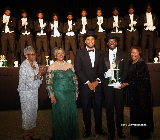 Dr. Bertha Murray, Mrs. Linda Dilworth, 2018 Beau of the Year Winston W.L. Bogan and Tallahassee Chapter of The Links, Incorporated's President Mrs. Alexis McMillan present 2019 Beau of the Year trophy to winner Duane Jacques Reece, Jr.